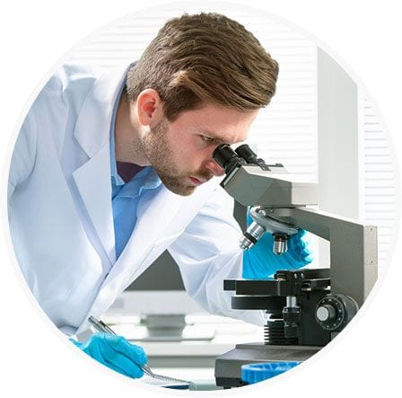 Lab Technician working on microscope
