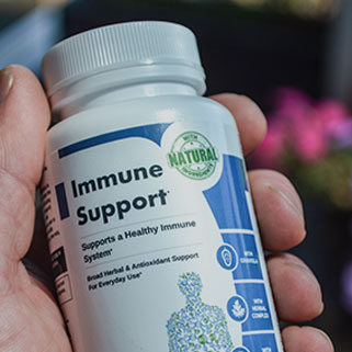 Immune Support Bottle in Hand