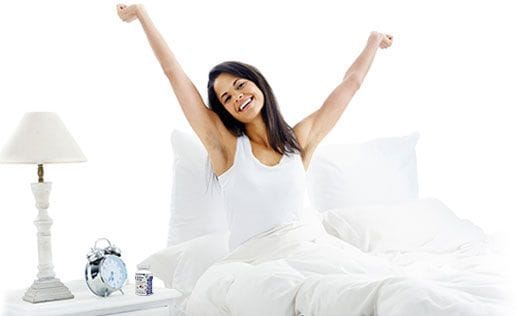 Image of a lady who wake up after having healthy deep sleep