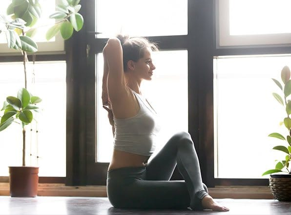 A young girl posing for yoga